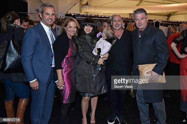 John Molner, Katie Couric, Hilaria Baldwin, Carmen Baldwin, Carmen Marc Valvo, and Alec Baldwin pose backstage at Carmen Marc Valvo fashion show...