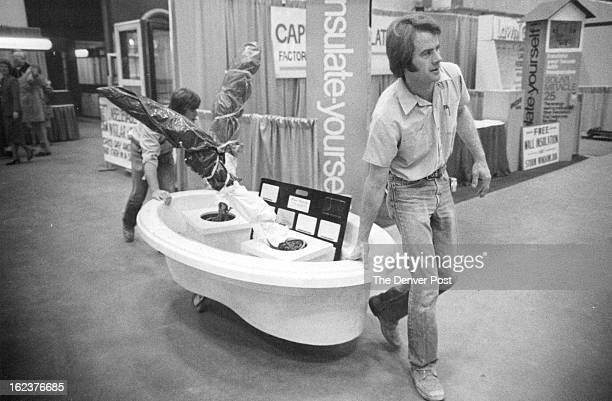 JAN 31 1981 John Molzer front right and Jeff Deitchel of Marquis Marble Co bring in a bathtub for their display Home furnishings and decorations will...