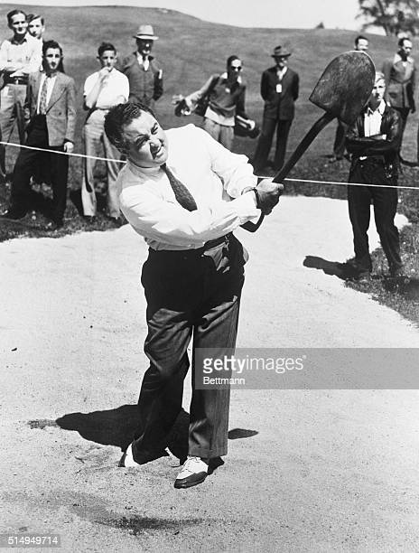 John Montague, mystery man of golf and trick shot artist, blasts his way out of a sand trap on a course here with a spade. Montague once used just a...