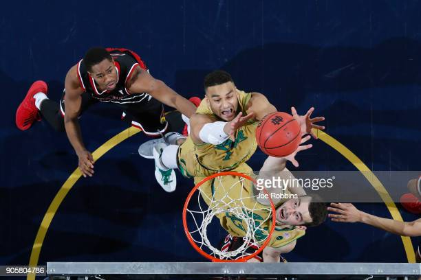 John Mooney and Austin Torres of the Notre Dame Fighting Irish rebound against VJ King of the Louisville Cardinals during a game at Purcell Pavilion...