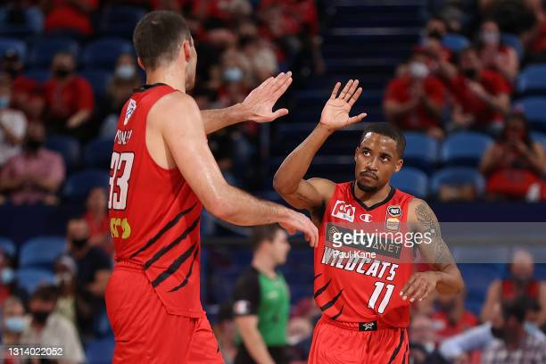 John Mooney and Bryce Cotton of the Wildcats celebrate a basket during the round 15 NBL match between the Perth Wildcats and the Brisbane Bullets at...