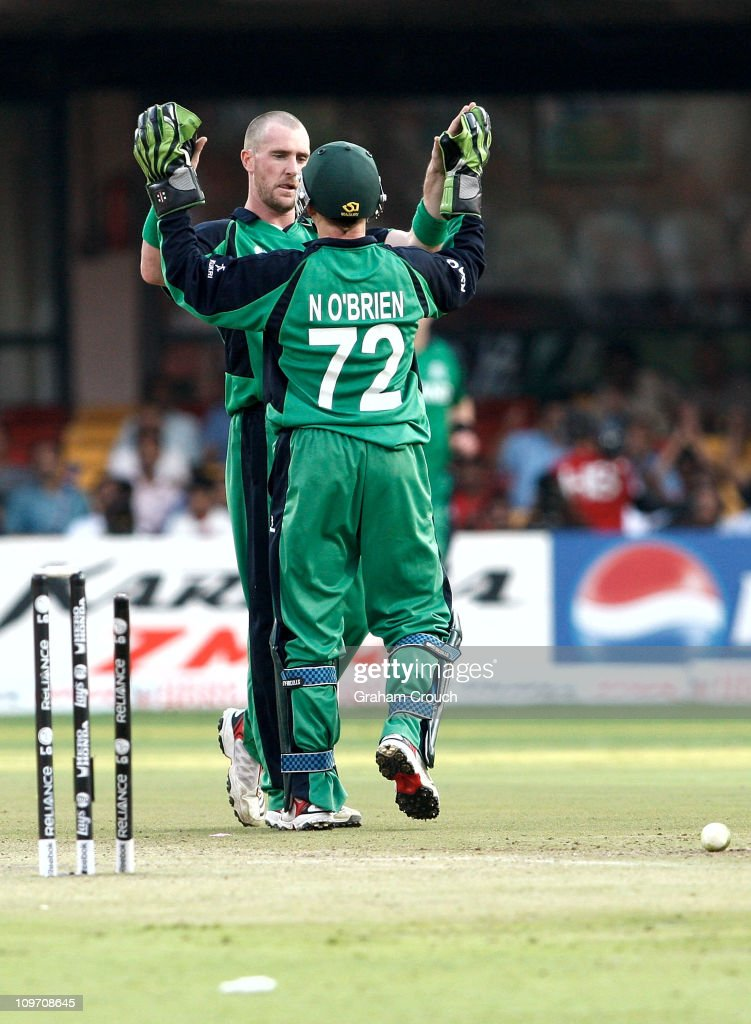 John Mooney and wicketkeeper Niall O'Brien of Ireland celebrate the wicket of Jonathan Trott of England bowled for 92 in the Group B 2011 ICC World Cup match between England and Ireland at M. Chinnaswamy Stadium on March 2, 2011 in Bangalore, India.