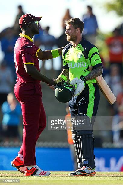 John Mooney of Ireland shakes hands with Darren Sammy of the West Indies at the conclusion of the 2015 ICC Cricket World Cup match between the West...