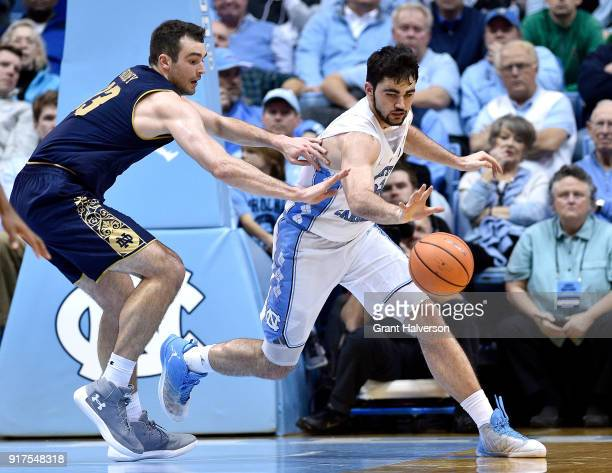 John Mooney of the Notre Dame Fighting Irish and Luke Maye of the North Carolina Tar Heels chase down a loose ball during their game at the Dean...