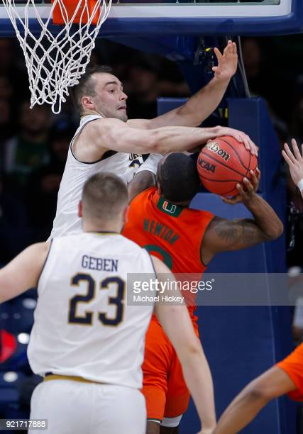 John Mooney of the Notre Dame Fighting Irish blocks the shot of Ja'Quan Newton of the Miami Hurricanes at Purcell Pavilion on February 19 2018 in...
