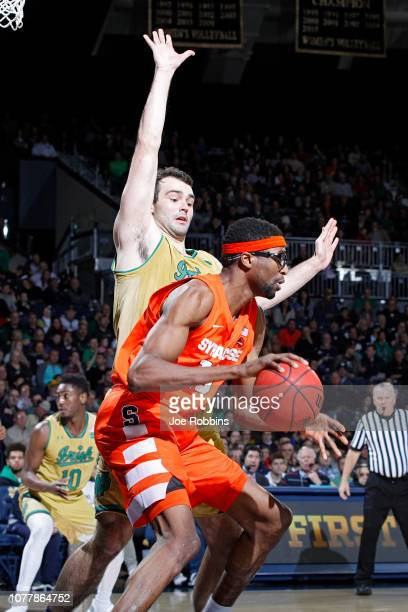 John Mooney of the Notre Dame Fighting Irish defends against Paschal Chukwu of the Syracuse Orange in the second half of the game at Purcell Pavilion...