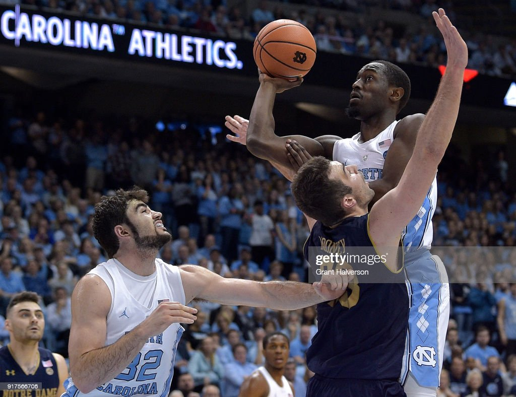 John Mooney #33 of the Notre Dame Fighting Irish defends Theo Pinson #1 of the North Carolina Tar Heels during their game at the Dean Smith Center on February 12, 2018 in Chapel Hill, North Carolina. North Carolina won 83-66.