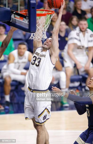 John Mooney of the Notre Dame Fighting Irish dunks the ball against the Pittsburgh Panthers at Purcell Pavilion on February 28 2018 in South Bend...