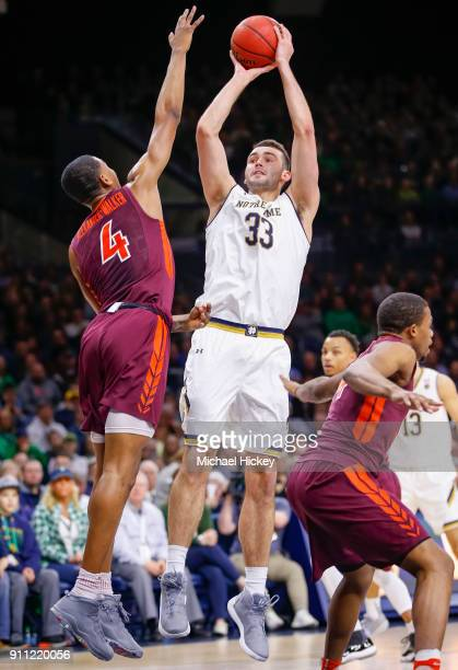 John Mooney of the Notre Dame Fighting Irish shoots the ball against Nickeil AlexanderWalker of the Virginia Tech Hokies at Purcell Pavilion on...