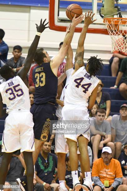 John Mooney of the Notre Dame Fighting Irish takes a shot over Wayde Sims of the LSU Tigers during a semifinal college basketball game at the Maui...