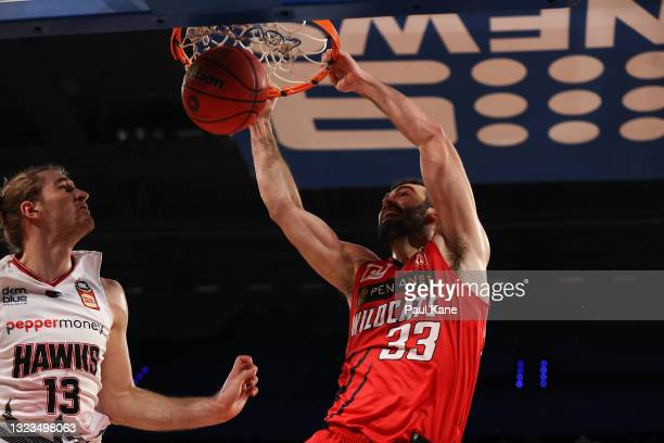 John Mooney of the Wildcats dunks the ball during game three of the NBL Semi-Final Series between the Perth Wildcats and the Illawarra Hawks at RAC...