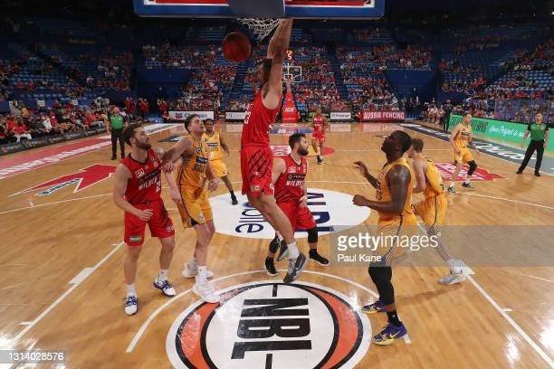 John Mooney of the Wildcats dunks the ball during the round 15 NBL match between the Perth Wildcats and the Brisbane Bullets at RAC Arena, on April...