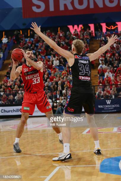 John Mooney of the Wildcats looks to pass the ball during game one of the NBL Grand Final Series between the Perth Wildcats and Melbourne United at...