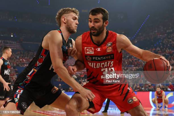 John Mooney of the Wildcats works to the basket against Jock Landale of Melbourne United during game one of the NBL Grand Final Series between the...