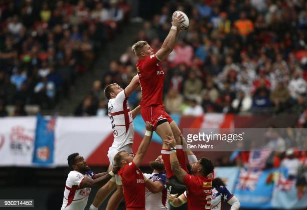 John Moonlight of Canada catches the ball near Ben Pinkelman of the United States during the Canada Sevens the Sixth round of the HSBC Sevens World...