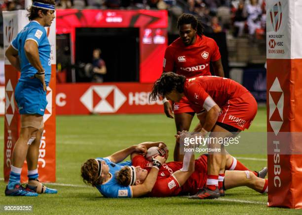 John Moonlight of Canada is congratulated by Nathan Hirayama after his score during Game Canada vs Uruguay Pool A match at the Canada Sevens held...