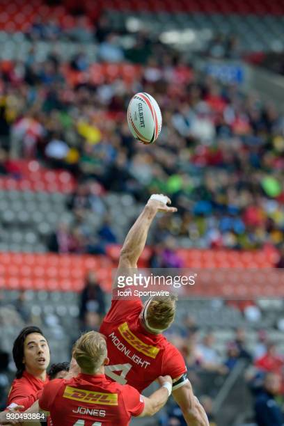 John Moonlight of Canada reaches for the ball against Scotland during day 2 of the 2018 Canada Sevens Rugby Tournament on March 11 2018 at BC Place...