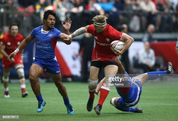 John Moonlight of Canada runs the ball against Murphy Paulo of Samoa during the Canada Sevens the Sixth round of the HSBC Sevens World Series at the...