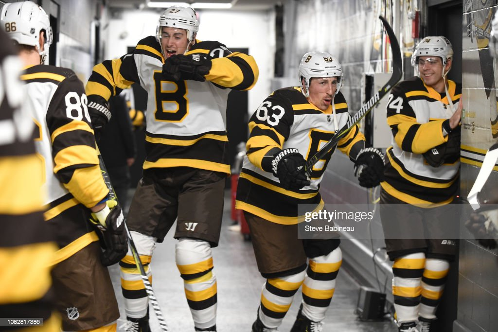 new style a2965 49e15 John Moore and Brad Marchand of the Boston Bruins in the ...