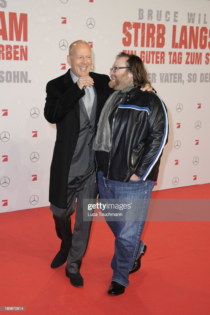 John Moore and Bruce Willis attend the premiere of 'Die Hard - Ein Guter Tag Zum Sterben' at Sony Center on February 4, 2013 in Berlin, Germany.