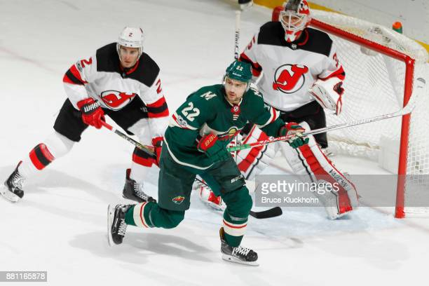 John Moore and goalie Cory Schneider of the New Jersey Devils defend against Nino Niederreiter of the Minnesota Wild during the game at the Xcel...
