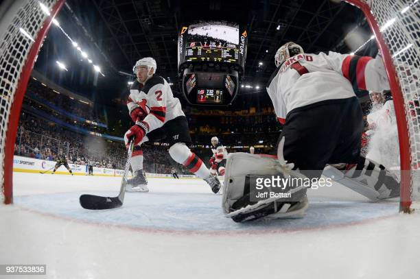 John Moore and Keith Kinkaid of the New Jersey Devils tend the net against the Vegas Golden Knights during the game at TMobile Arena on March 14 2018...