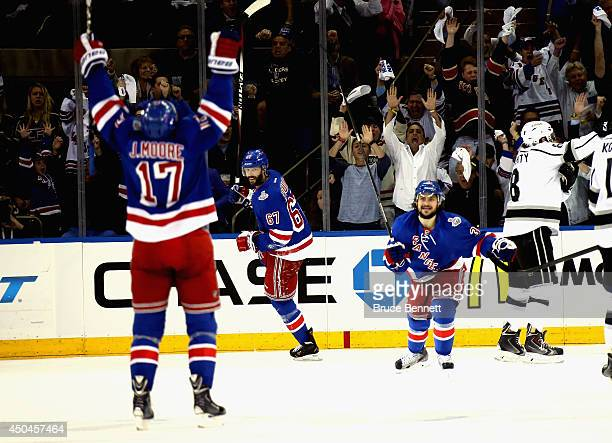 John Moore Benoit Pouliot and Mats Zuccarello of the New York Rangers celebrate Pouliot's goal on Jonathan Quick of the Los Angeles Kings during the...
