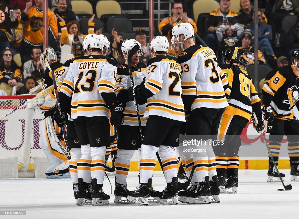 buy online 0e171 c584d John Moore of the Boston Bruins celebrates his goal with ...