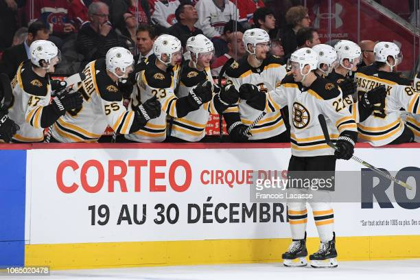 John Moore of the Boston Bruins celebrates with the bench after scoring a goal against the Montreal Canadiens in the NHL game at the Bell Centre on...