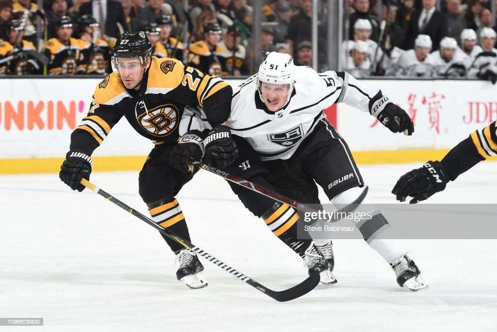 new style 55f61 a4fea John Moore of the Boston Bruins skates against Austin Wagner ...