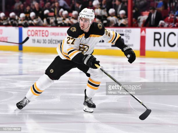 John Moore of the Boston Bruins skates against the Montreal Canadiens during the NHL game at the Bell Centre on November 24 2018 in Montreal Quebec...