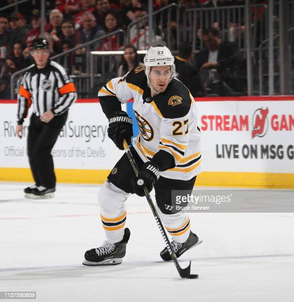 John Moore of the Boston Bruins skates against the New Jersey Devils at the Prudential Center on March 21, 2019 in Newark, New Jersey. The Bruins...