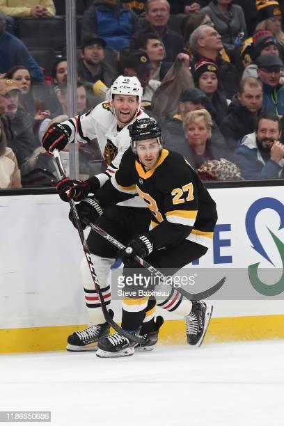 John Moore of the Boston Bruins skates against Zack Smith of the Chicago Blackhawks at the TD Garden on December 5, 2019 in Boston, Massachusetts.