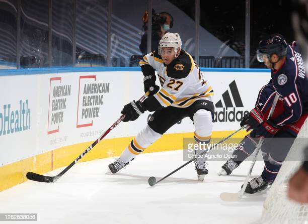John Moore of the Boston Bruins skates during the first period of an exhibition game prior to the 2020 NHL Stanley Cup Playoffs at Scotiabank Arena...