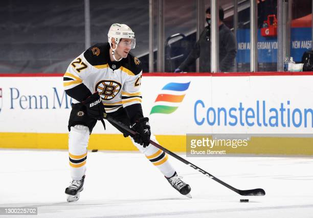 John Moore of the Boston Bruins skates in warm-ups prior to the game against the Philadelphia Flyers at Wells Fargo Center on February 03, 2021 in...
