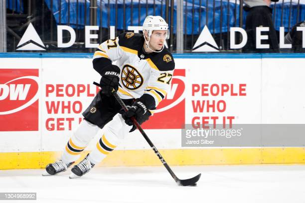 John Moore of the Boston Bruins skates with the puck against the New York Rangers at Madison Square Garden on February 26, 2021 in New York City.