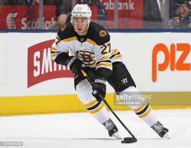 John Moore of the Boston Bruins skates with the puck against the Toronto Maple Leafs during an NHL game at Scotiabank Arena on November 26 2018 in...