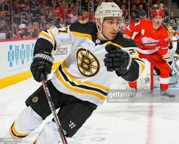 John Moore of the Boston Bruins turns up ice against the Detroit Red Wings during an NHL game at Little Caesars Arena on February 9, 2020 in Detroit,...