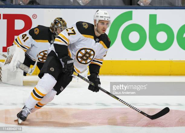 John Moore of the Boston Bruins warms up prior to action against the Toronto Maple Leafs in Game Four of the Eastern Conference First Round during...