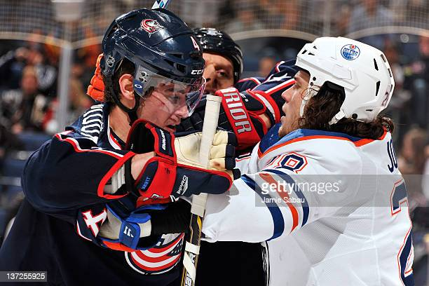John Moore of the Columbus Blue Jackets and Ryan Jones of the Edmonton Oilers push each other during the second period on January 17 2012 at...