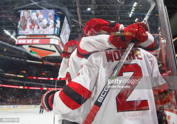 John Moore of the New Jersey Devils celebrates his gamewinning overtime goal against the Ottawa Senators with teammates at Canadian Tire Centre on...