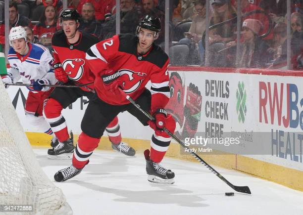 John Moore of the New Jersey Devils controls the puck during the game against the New York Rangers at Prudential Center on April 3 2018 in Newark New...