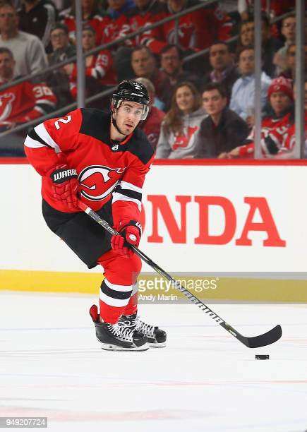 John Moore of the New Jersey Devils controls the puck in Game Four of the Eastern Conference First Round against the Tampa Bay Lightning during the...