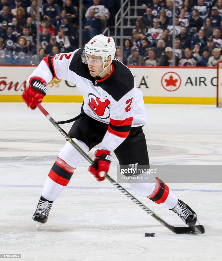 quality design cc3a5 69242 John Moore of the New Jersey Devils gets set to pass the ...
