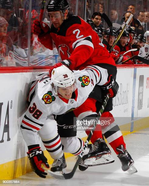 John Moore of the New Jersey Devils in action against Ryan Hartman of the Chicago Blackhawks on December 23 2017 at Prudential Center in Newark New...