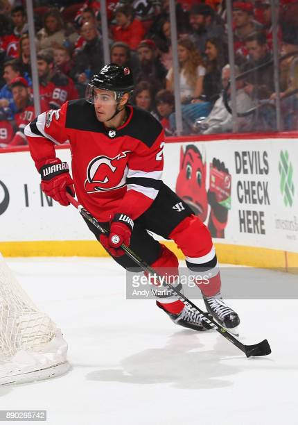 John Moore of the New Jersey Devils plays the puck against the Columbus Blue Jackets during the game at Prudential Center on December 8 2017 in...