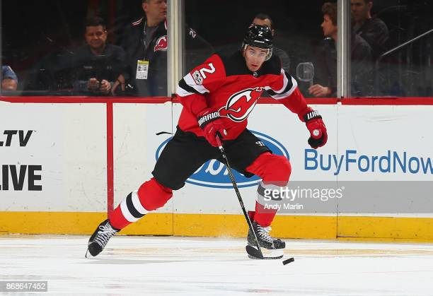 John Moore of the New Jersey Devils plays the puck against the Ottawa Senators during the game at Prudential Center on October 27 2017 in Newark New...