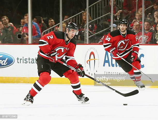 John Moore of the New Jersey Devils plays the puck during the game against the Buffalo Sabres at the Prudential Center on April 5 2016 in Newark New...