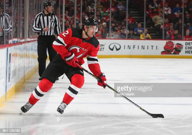 John Moore of the New Jersey Devils plays the puck during the game against the New York Islanders at Prudential Center on March 31 2018 in Newark New...