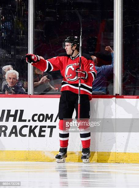 John Moore of the New Jersey Devils reacts after scoring a secondperiod goal against the Pittsburgh Penguins during an NHL game at Prudential Center...